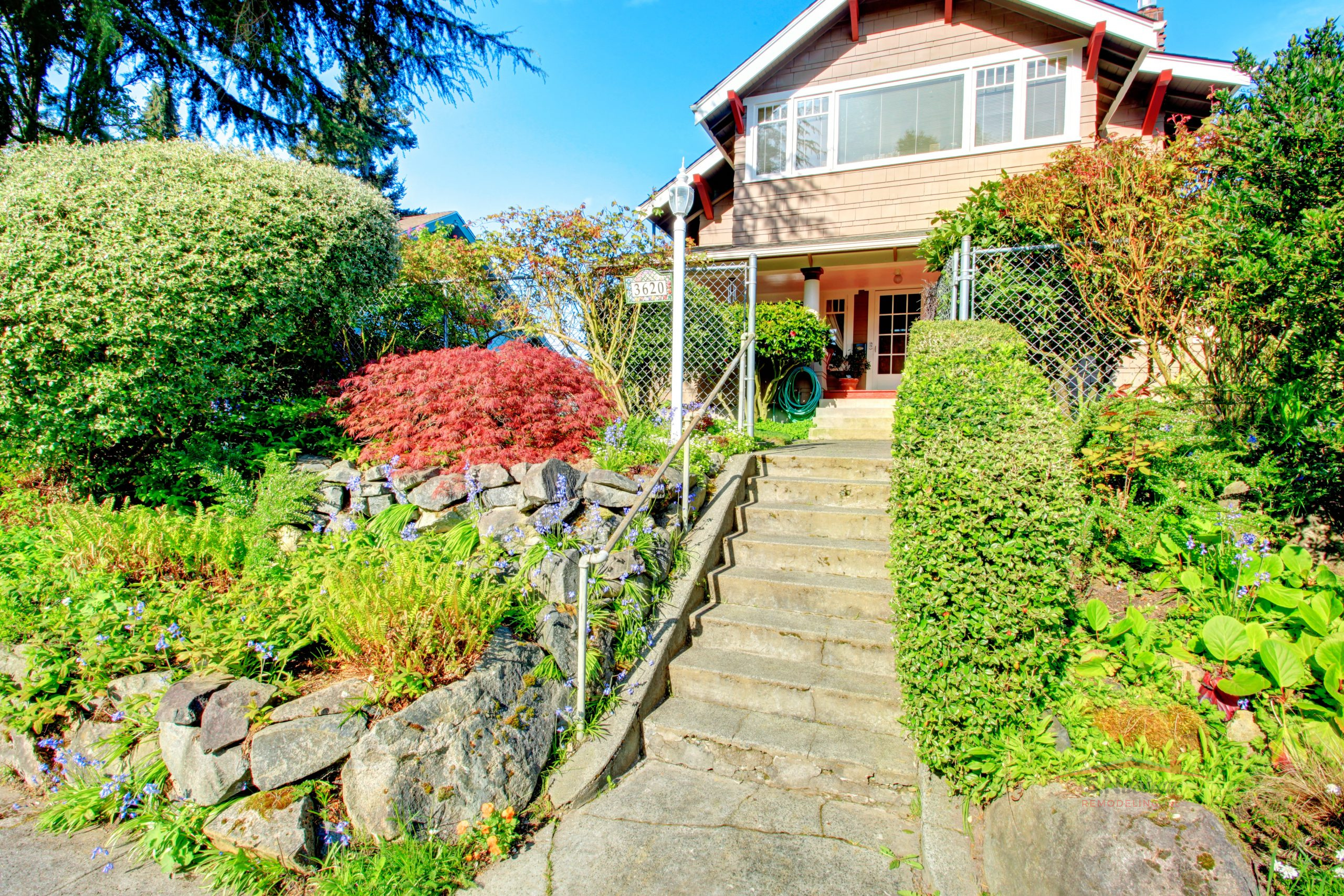 Big house with beautiful curb appeal and entrance gate