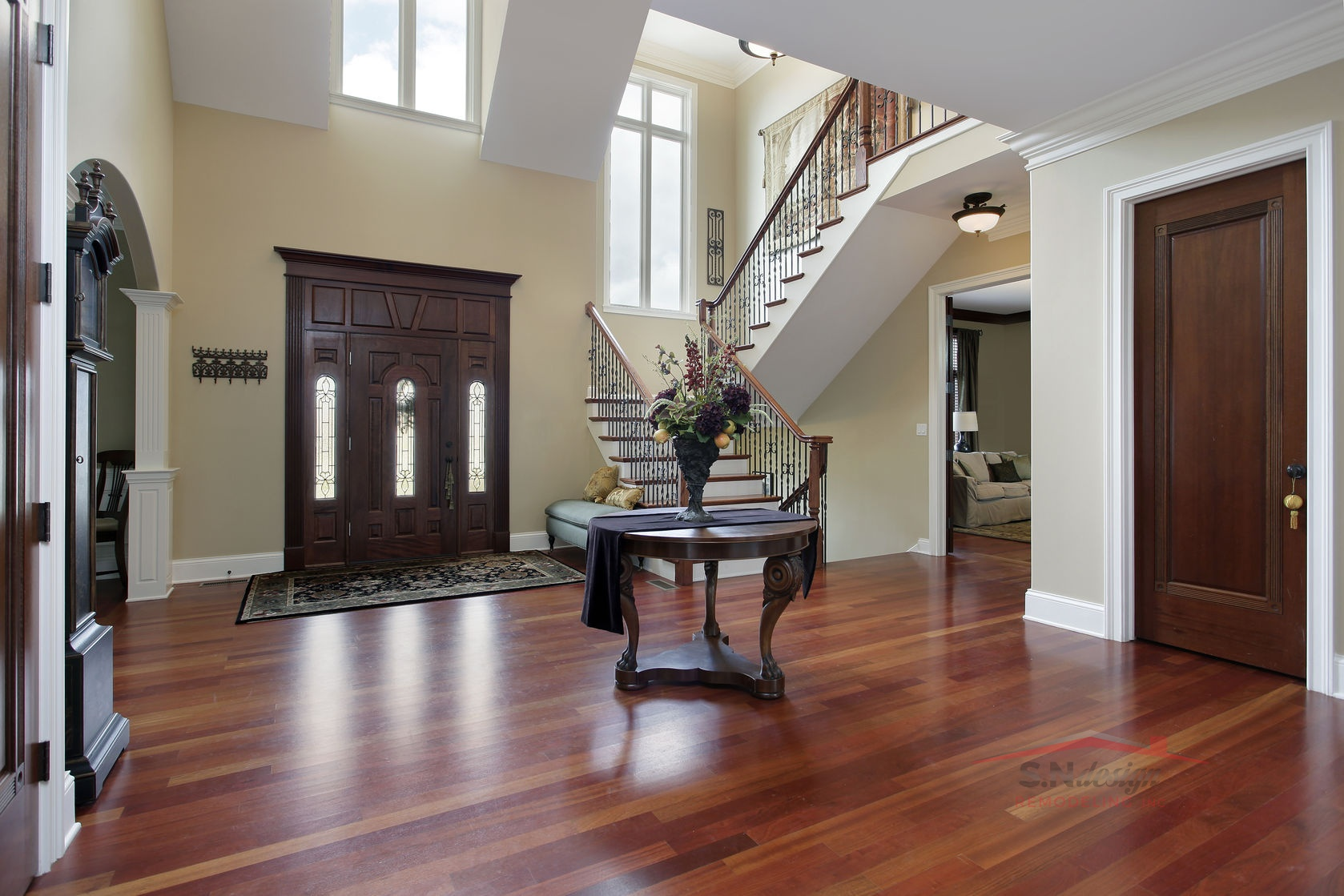 23889075 - foyer in luxury home with cherry wood flooring